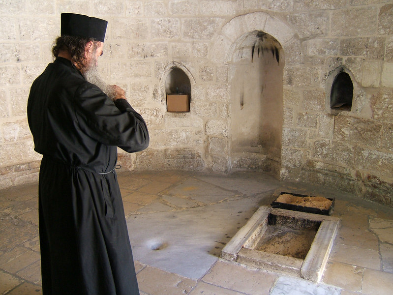 Monk Looking at Christ's last Footprint in Ascension Chappel, Jerusalem